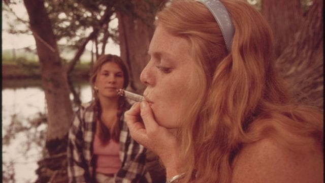 https://mk0muggleheadfl9s2sr.kinstacdn.com/wp-content/uploads/2020/06/1600px-ONE_GIRL_SMOKES_POT_WHILE_HER_FRIEND_WATCHES_DURING_AN_OUTING_IN_CEDAR_WOODS_NEAR_LEAKEY_TEXAS._TAKEN_WITH..._-_NARA_-_554906-640x360.jpg