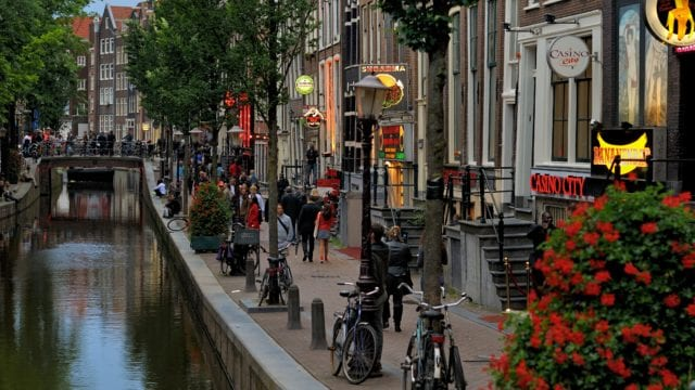 https://mugglehead.com/wp-content/uploads/2020/07/Red-light_district_of_Amsterdam_by_day._2012-640x360.jpg