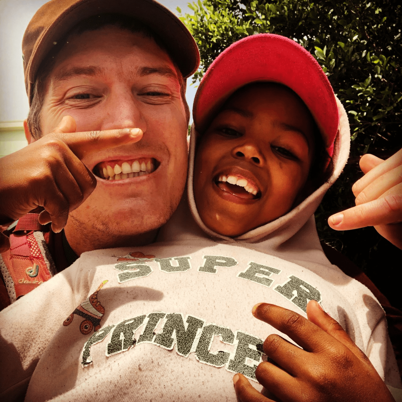 South Africa National Cannabis Master Plan.-MJ Stowe with one of SANPUD beneficiaries' children, which was taken during outreach.